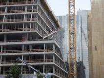 Cranes in Berlin city centre. Berlin, Germany - June 5, 2018: Cranes and buildings under construction royalty free stock photos