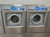 Laundry shop. Berlin, Germany - June 25, 2018: Electrolux washing machines in a laundry shop. Electrolux AB is a Swedish multinational home appliance stock image