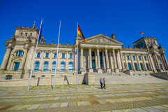 BERLIN, GERMANY - JUNE 06, 2015: Germany national flags outside of Reichstag building on Berlin Royalty Free Stock Images