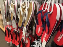Miniso flip flops. Berlin, Germany - June 20, 2018: Miniso flip flops displayed in a row for sale. MINISO is a Japan-based designer brand stock image