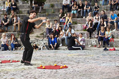 Street Performer at Mauerpark Amphitheater. Berlin, Germany - June 10th, 2012: Early summer Sunday afternoon at Mauerpark. A street performer doing a show in Stock Images