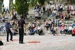 Street Performers at Mauerpark Amphitheater. Berlin, Germany - June 10th, 2012: Early summer Sunday afternoon at Mauerpark. Two street performers doing a show in Royalty Free Stock Photography