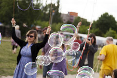Making Soap Bubbles at Mauerpark. Berlin, Germany - June 10th, 2012: A group of young adults making giant soap bubbles on an early summer Sunday afternoon at Stock Photography