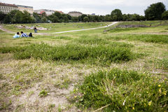 Leisure Time in Gorlitzer Park Berlin Germany. Berlin, Germany - June 11th, 2012: Groups of young adults scattered on the grass at Gorlitzer park, located in Stock Image