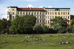 Leisure Time in Gorlitzer Park Berlin Germany. Berlin, Germany - June 8th, 2012: Groups of young adults and teenagers scattered on the grass at Gorlitzer park Royalty Free Stock Photo