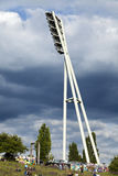 Mauerpark Stadium Lighting Tower and Hill Berlin Germany. Berlin, Germany - June 10th, 2012: Spring Sunday afternoon at Mauerpark in east Berlin. People are Royalty Free Stock Photos