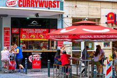 BERLIN, GERMANY - JUNE 10 2017: A vending stall with outside tables of the latest fastfood craze in Berlin, the stock photography
