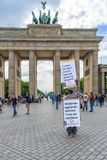 183/5000 Berlin Germany 16-5-2018 A man stands with his big protest sign, on which he accused the Zionists, that they would manage stock image