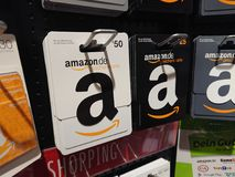 Amazon gift cards. Berlin, Germany - March 13, 2018: Amazon gift cards. Founded in 1994, Amazon.com is an American electronic commerce and cloud computing royalty free stock image