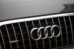 Audi car emblem. Berlin, Germany - March 23, 2018: Audi company emblem on black car. Audi AG is a premium German automobile manufacturer that designs, engineers Royalty Free Stock Photos
