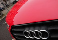 Audi company emblem on red car. Berlin, Germany - March 7, 2018: Audi company emblem on red car. Audi AG is a premium German automobile manufacturer that designs Royalty Free Stock Images