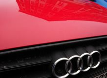 Audi company emblem on red car. Berlin, Germany - March 7, 2018: Audi company emblem on red car. Audi AG is a premium German automobile manufacturer that designs Royalty Free Stock Photos