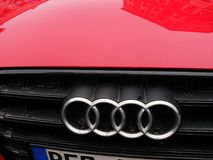Audi company emblem on red car. Berlin, Germany - March 7, 2018: Audi company emblem on red car. Audi AG is a premium German automobile manufacturer that designs Royalty Free Stock Image