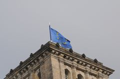 GERMAN PARLIAMENT BUILDING REICHTAG AND BUNDESTAG. Berlin /Germany . 05 March 2019. German and europeain nion flags fly over German bundestag or reichtag and royalty free stock photos