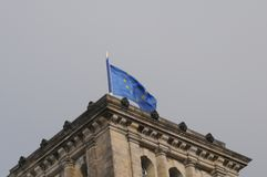 GERMAN PARLIAMENT BUILDING REICHTAG AND BUNDESTAG. Berlin /Germany . 05 March 2019. German and europeain nion flags fly over German bundestag or reichtag and stock photo