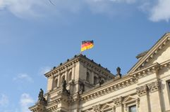 GERMAN PARLIAMENT BUILDING REICHTAG AND BUNDESTAG. Berlin /Germany . 05 March 2019. German and europeain nion flags fly over German bundestag or reichtag and stock photography