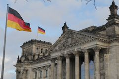 GERMAN PARLIAMENT BUILDING REICHTAG AND BUNDESTAG. Berlin /Germany . 05 March 2019. German and europeain nion flags fly over German bundestag or reichtag and royalty free stock image