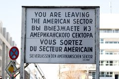 You are leaving the American sector. Berlin, Germany - March 19, 2018: You are leaving the American sector. Sign placed by the Checkpoint Charlie in Berlin in Stock Photo