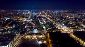 BERLIN, GERMANY - MAY,2019: Aerial drone timelapse hyperlapse view of Berlin city centre from above at night.