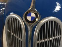 BMW vintage car hood. Berlin, Germany - May 13, 2017: Blue BMW vintage car, detail. BMW Bayerische Motoren Werke is a German automobile, motorcycle and engine stock photography