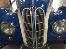 BMW vintage car bonnet. Berlin, Germany - May 13, 2017: Blue BMW vintage car, detail. BMW Bayerische Motoren Werke is a German automobile, motorcycle and engine Stock Images