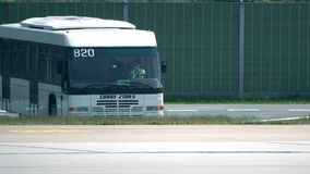 BERLIN, GERMANY - MAY, 18, 2017. Cobus airfield bus withfemale driver driving at the airport Stock Photos