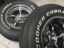 Cooper Cobra tires. Berlin, Germany - May 13, 2017: Cooper Cobra Radial GT Tires. Cooper Tire & Rubber Company is an American company that specializes in the stock photo