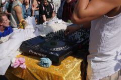 Male DJ playing party music outdoors royalty free stock images