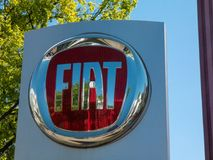 Fiat car dealership. Berlin, Germany - May 6, 2018: Fiat car dealership signboard. Fiat is Italy`s largest auto maker. From the beginning Fiat logo had alphabets royalty free stock photography