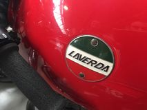 Laverda emblem on a red vintage motorcycle. Berlin, Germany - May 13, 2017: Laverda emblem. Laverda was an Italian manufacturer of high performance motorcycles Royalty Free Stock Photography