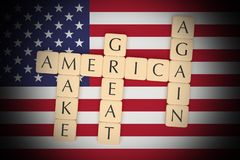 Letter Tiles Make America Great Again With US Flag, 3d illustration royalty free stock photography