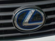Lexus car sign. Berlin, Germany - May 6, 2018: Lexus car emblem. Luxury vehicle division of Japanese car maker Toyota, Lexus marque is marketed in more than 70 Royalty Free Stock Photo