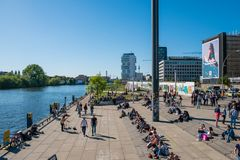Many people at river Spree at Berlin Wall  East Side Gallery o. Berlin, Germany - may, 2018:  Many people at river Spree at Berlin Wall  East Side Gallery on a Royalty Free Stock Photos
