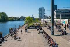 Many people at river Spree at Berlin Wall  East Side Gallery o. Berlin, Germany - may, 2018:  Many people at river Spree at Berlin Wall  East Side Gallery on a Stock Images