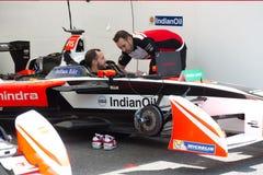 Mechanic checking a racing car stock images