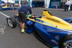 Mechanic checking a racing car stock image