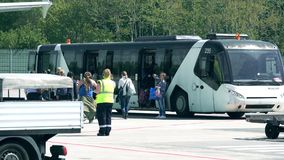 BERLIN, GERMANY - MAY, 18, 2017. Passengers boarding Neoplan airfield bus at the airport Royalty Free Stock Image
