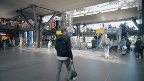 BERLIN, GERMANY - MAY 1, 2018. Passengers at Main railway station. BERLIN, GERMANY - MAY 1, 2018 Hauptbahnhof or Main railway station Stock Images
