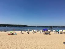 People enjoying the Hot Weather at Wannsee Beach Strandbad Wannsee. Berlin, Germany - May 29 2018: People enjoying the Hot Weather at Wannsee Beach Strandbad royalty free stock image