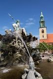 Eople in front of the Neptune fountain - Neptunbrunnen with Greek god Poseidon and woman statues in Berlin, Germany. BERLIN, GERMANY - MAY 15 2018: People in Stock Photos