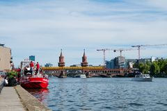 River, boats and Oberbaum Bridge Oberbaumbruecke in Berlin on. Berlin, Germany - may, 2018:  River, boats and Oberbaum Bridge Oberbaumbruecke in Berlin on a Stock Photos