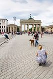 Tourists taking pictures in front of Brandenburger Tor - Brandeburg gate in Berlin, Germany. BERLIN, GERMANY - MAY 15 2018: Tourists taking pictures in front of stock images