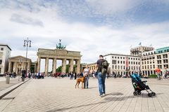 Tourists taking pictures in front of Brandenburger Tor - Brandeburg gate in Berlin, Germany. BERLIN, GERMANY - MAY 15 2018: Tourists taking pictures in front of stock photos
