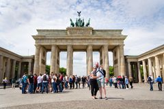 Tourists taking pictures in front of Brandenburger Tor - Brandeburg gate in Berlin, Germany. BERLIN, GERMANY - MAY 15 2018: Tourists taking pictures in front of royalty free stock photos