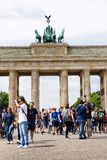 Tourists taking pictures in front of Brandenburger Tor - Brandeburg gate in Berlin, Germany. BERLIN, GERMANY - MAY 15 2018: Tourists taking pictures in front of royalty free stock photo