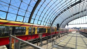 BERLIN, GERMANY - MAY 27, 2017: Train arriving and other departing on Berlin Hauptbahnhof at the same time