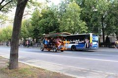 Berlin, Germany, 2014: `Mobile` pub goes along Belina Street. Berlin, Germany, 2014: Six people ride a mobile pub-bike along Berlin Street Stock Image