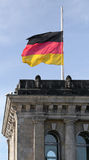 Berlin, Germany. The national flaf on the Reichstag cover Royalty Free Stock Photography