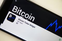 Berlin, Germany - November 19, 2017: Bitcoin Ticker Widget application on screen of modern smartphone close-up royalty free stock photo