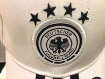 German Football Association logo. Berlin, Germany - November 28, 2017: German Football Association German for Deutsche Fussball-Bund logo on a white hat. The Stock Image